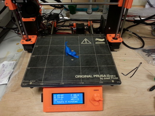 Cat Download Complete. Stretching cat print on a Prusa 3D printer.